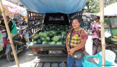 The watermelon lady at Gotong Royong market, Bukit Lawang. Photo copyright: David Bartholomew